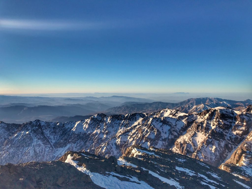 Snowy mountain view from the top of Mount Toubkal.